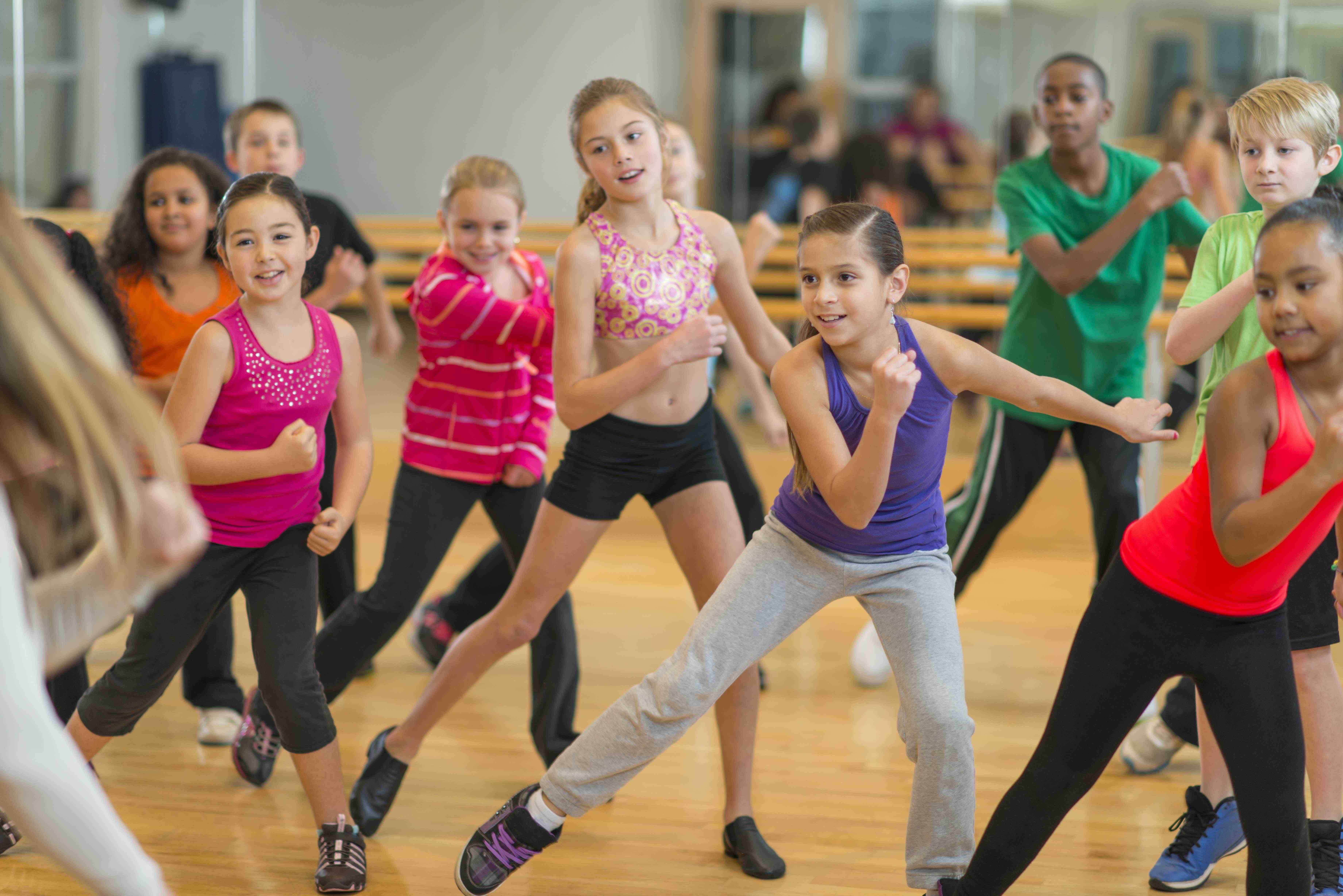 Diverse group of children taking a dance fitness class